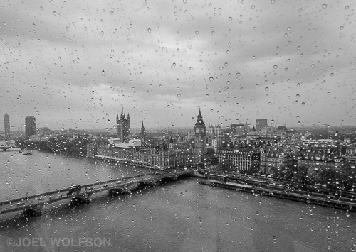 Raining in London? Imagine that! We only had a day in London so one must make the most of it. I shot this from the London Eye, a giant ferris wheel on the River Thames. I wanted to capture the feel of a rainy day looking out the window on London. I chose black and white so color wouldn't distract from the texture, especially the raindrops. With a quick flip of the lever I used the EVF (Electronic Viewfinder) for two reasons- very wide angle lens and to double check that I was holding focus and the scene and still be able to clearly make out the raindrops. Fuji 14mm f2.8 1/60 sec f16 ISO 2000.